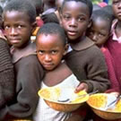Boys with food bowls in the Ivory Coast.