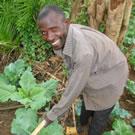 Man hoeing crops in Kenya.