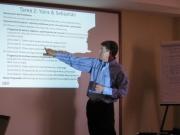 Tim Magee making a presentation at a workshop.